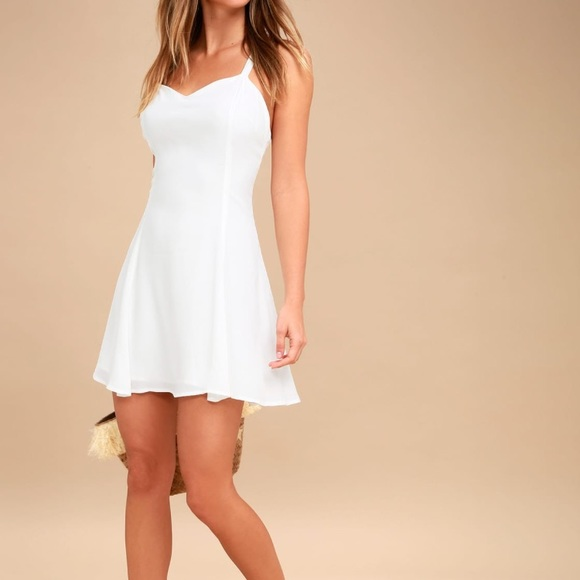 9d0cde00750 White dress NWT strappy and cute summer dress. NWT. Lulu s